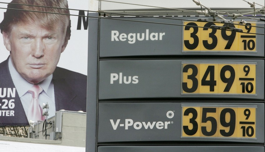 Gasoline prices are displayed on a sign at a Shell gas station as an image of Donald Trump appears on a billboard nearby April 24, 2006 in San Francisco, California. (Justin Sullivan | Getty Images)